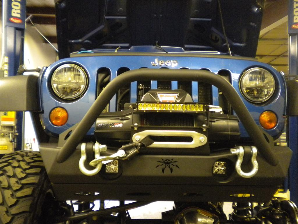 Front of a blue Jeep