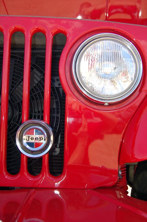 Front of red Jeep