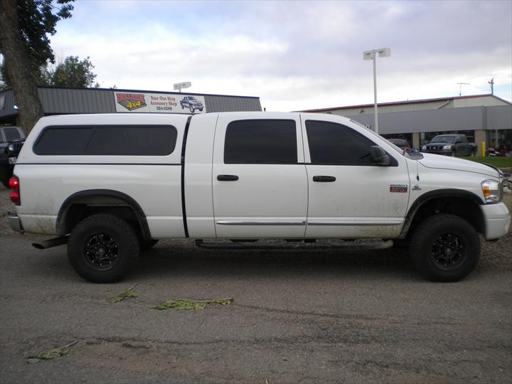 White Dodge Pick Up with cab topper