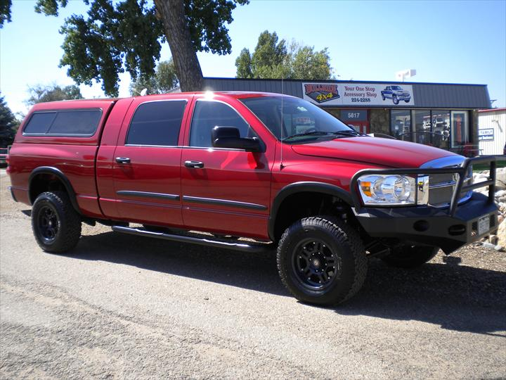 Red Dodge Pick Up with cab topper