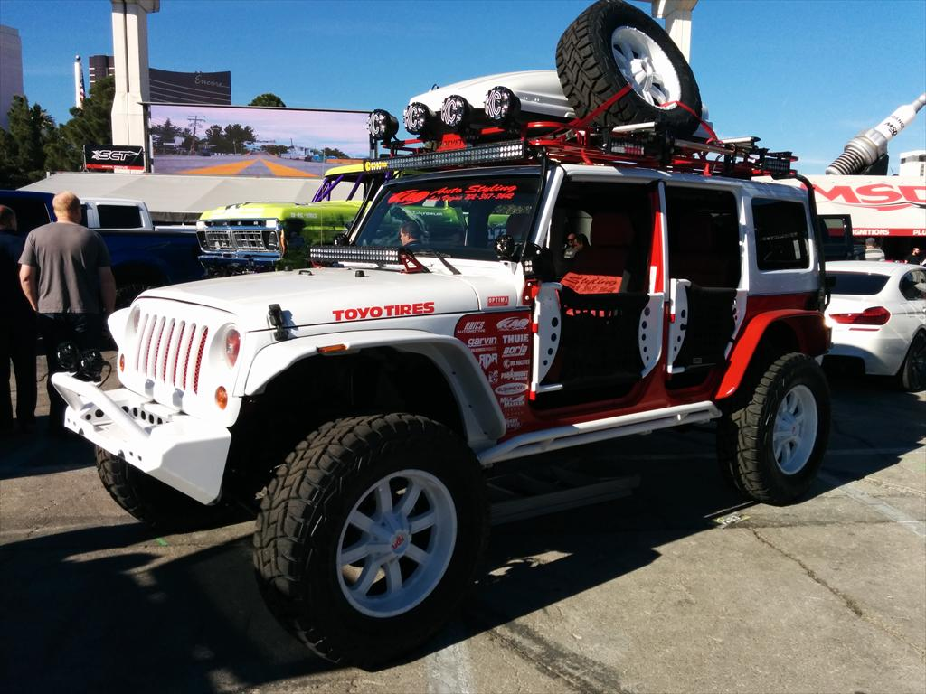 White Jeep with red detail