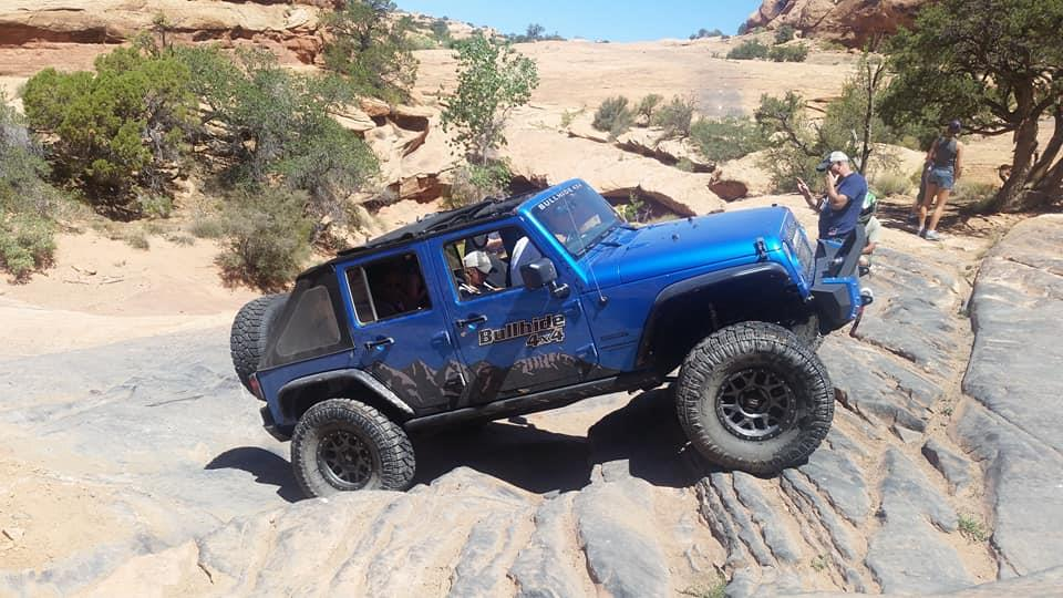 Blue Jeep off-roading