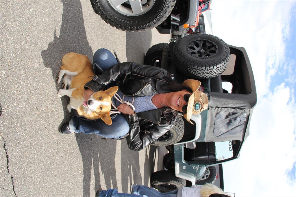 Corgi, owner, and a Jeep