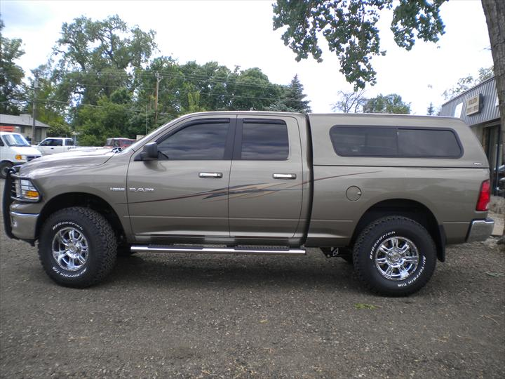 Grey Brown Dodge Pick Up with cab topper