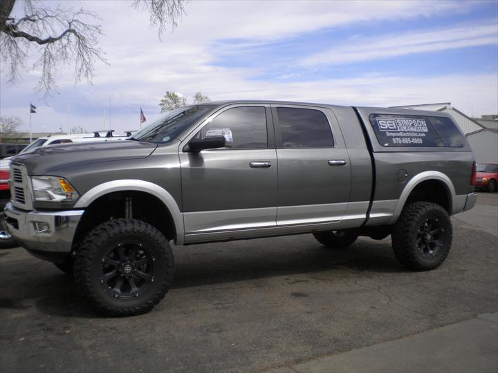 Grey Dodge Pick Up with cab topper