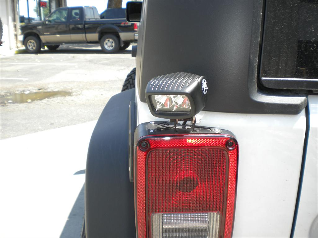 Tail light on a white Jeep