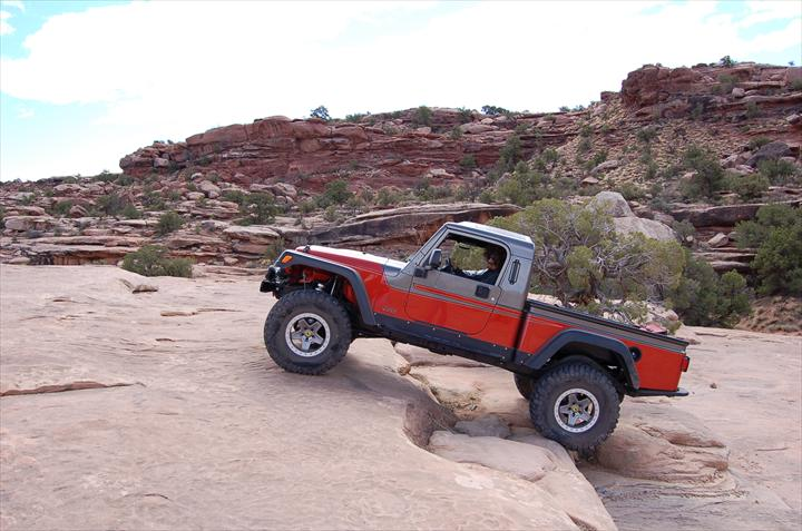 Red Jeep off-roading