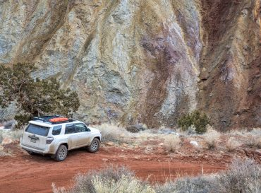Moab , UT, USA - February 9, 2020:  Toyota 4runner SUV (2016 trail edition, stock vehicle) with recovery ladders on roof racks on a desert canyon road - Onion Creek Trail, recreation concept.